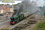 "GWR ""Castle"" 4-6-0 No. 5043 ""Earl of Mount Edgcumbe"" is working a ""Cathedrals Express"", 1Z97, 06:30 from Tyseley Warwick Road to Paddington via Kidderminster, Worcester and Oxford. It is making a very smoky (and noisy!) departure from the stop at Moreton-in-Marsh, running a little late at 09:25 on Saturday 17th September 2011. An awkwardly placed car has been digitally removed from the car park! Digital Image No. GMPI10325."
