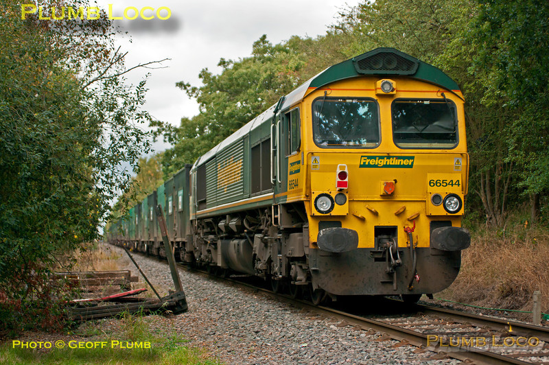 """66544 is dead on the rear of 6M22, the 08:21 loaded """"binliner"""" from Cricklewood to Calvert, with classmate 66507 hauling the train. It is just about to enter the unloading sidings at Calvert at 13:10 on Friday 21st September 2012. Photo taken from a public footpath across the line. Digital Image No. GMPI12494."""