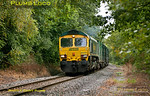 "Freightliner 66507 is still working hard as it runs through Sheephouse Woods on the final stretch into Calvert on the former Great Central main line. It is at the head of 6M22, the 08:21 from Cricklewood loaded ""binliner"" train, which unusually, had 66544 dead on the rear. 13:10, Friday 21st September 2012. Photo taken from a public footpath across the line. Digital Image No. GMPI12490."