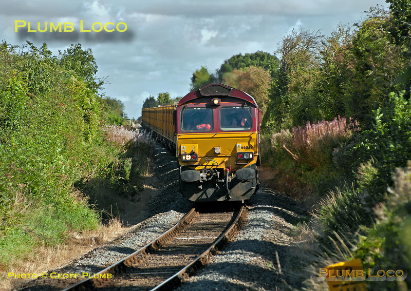"DBS 66039 descends the grade from Monks Risborough towards Princes Risborough at Park Mill Farm crossing whilst working 6A58, the 10:14 from Calvert to Northolt empty ""binliner"" train along the branch from Aylesbury. 11:07, Wednesday 19th September 2012. Digital Image No. GMPI12431."