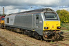 67015 in its obsolete Wrexham & Shropshire livery is seen on Didcot stabling point, complete with overhauled bogies & wheelsets 11/10/2014.