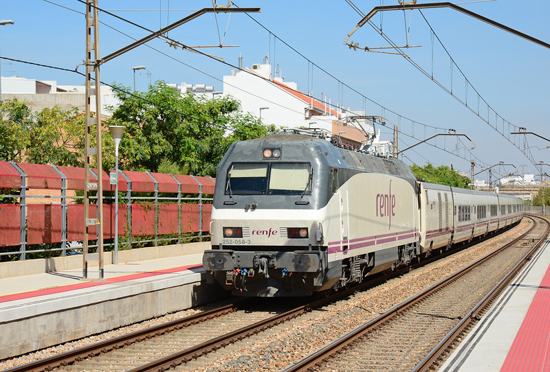 Renfe electric locomotive 252-058-3 is seen passing through Massanassa Valencia with a Altaria Talgo service.