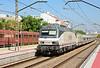 Renfe electric locomotive 252-058-3 is seen passing through Massanassa Valencia with a Altaria Talgo service.