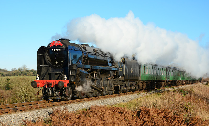 In some welcome Winter sun 9F 92212 is seen in action at the Mid Hants, with a Santa special 06/12/2014.