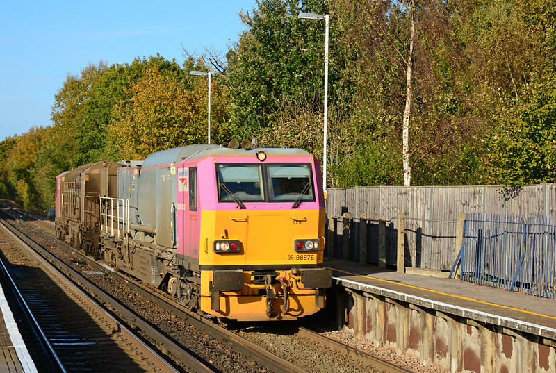 MPV Dr98976 is seen passing through Sunningdale on water cannon duty 3S83 from Effingham Jctn 10/11/2014. <br /> This service will visit most lines on its circular route, before returning to Effingham Jctn carraige shed.