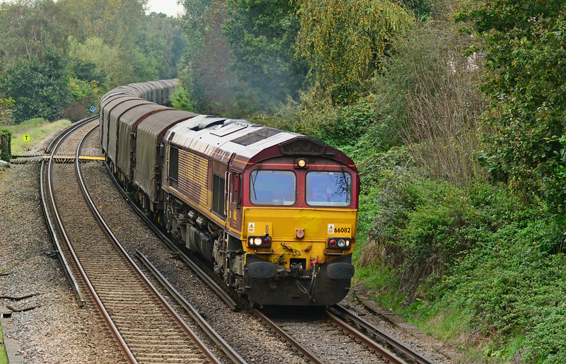 DB Schenker 66082 has charge of 6O32 Llanwern exchange sidings - Dollands Moor covered steel train, seen here having just departed Wokingham 12/10/2014.