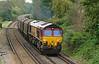 DB Schenker 66082 has charge of 6O32 Llanwern exchange sidings - Dollands Moor covered steel train, seen here having just departed Wokingham 12/10/2014.