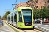 Murcia Tram 158 is seen departing Juan Carlos 1 heading for Estadio Nueva Condomina.