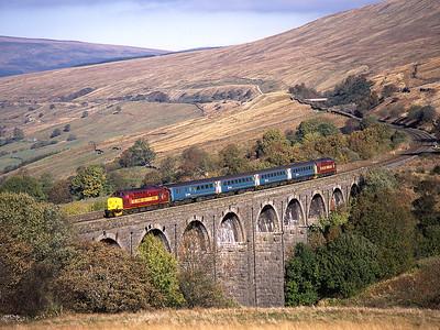 37408 & 37405 cross Dent Head viaduct with the 09.49 Leeds-Carlisle 18/10/03.