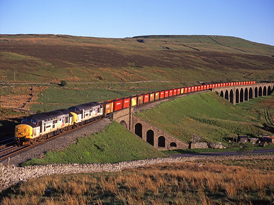 37407 + 37413 haul the legendary 6M90 household coal train from Gascoigne Wood-Carlisle over Dandry mire viaduct 8/6/96.