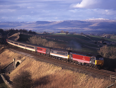 47702 pilots 47839 with a diverted cross country train at Birkett Common 13/3/99