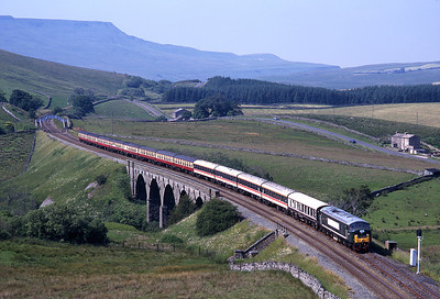 "D172 ""Ixion"" was the first preserved diesel passed for mainline running; on 20/7/96 it worked a Carlisle-Salisbury charter over the S&C seen here at Lunds viaduct."