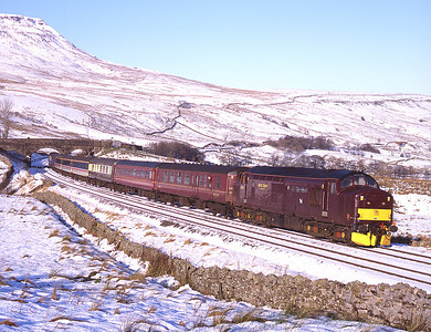 37676 climbs to Ais Gill with a Saltburn-Skipton charter on 6/12/08 with 47854 on the rear.