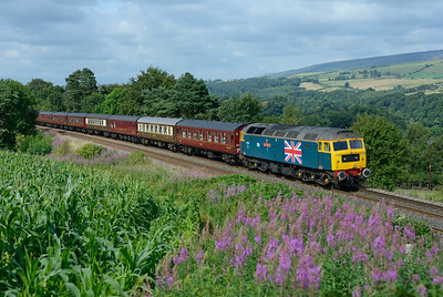 "On Sunday 20/7/14 the return leg of the ""Waverley"" steam tour was diesel hauled by 47580 ""County of Essex"", seen in a lucky patch of sun near Armathwaite."