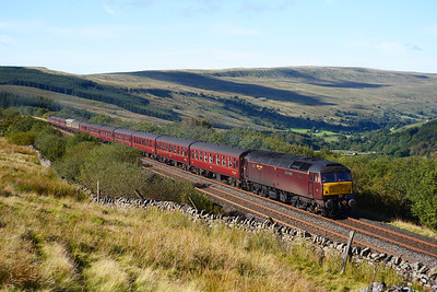 "A Cleethorpes-Edinburgh charter approaches Garsdale with 47854 ""Diamond Jubilee"" leading and 47786 ""Roy Castle OBE"" on the rear 22/9/12."
