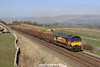 Colas Rail Freight 66850 Passes Greengates with the 12,44 Carlisle Yard-Chirk Loaded Timber on Monday,26th March 2012.