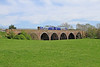 The 12.49 Leeds - Carlisle crosses Little Salkeld Viaduct on Monday,7th May 2018.