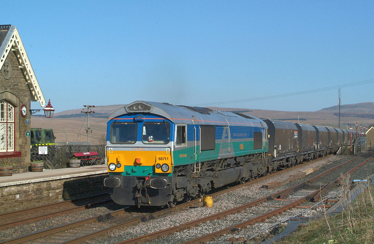 I wasn't sure whether I had time to get under RH Viaduct before this one arrived although in the event I had some 40 minutes to wait  before 66711 headed north through Ribblehead Station at 17.18hrs.with 6D77 16.43 Arcow Quarry-Hunslet Tilcon GBRf.