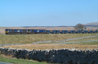 One last push now back into the quarry sidings for 66424+66302. Ribblehead. 19.4.2018.15.07hrs. 6Z21 09.15 Sellafield DRS-Ribblehead VQ.  The wagons had been on hire to DRS for working spoil down the Cumbrian Coast to Barrow .  Job now finished so wagons were being returned to GBRf  Wellingborough , but via Ribblehead VQ to collect a few wagons left there previously.