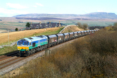 A few yards further north now with Salt Lake Cottages in view , 66711 makes for Blea Moor to run round with 6D77 16.43 Arcow Quarry GBRf-Hunslet Tilcon GBRf. 18th April 2018 16.57hrs.