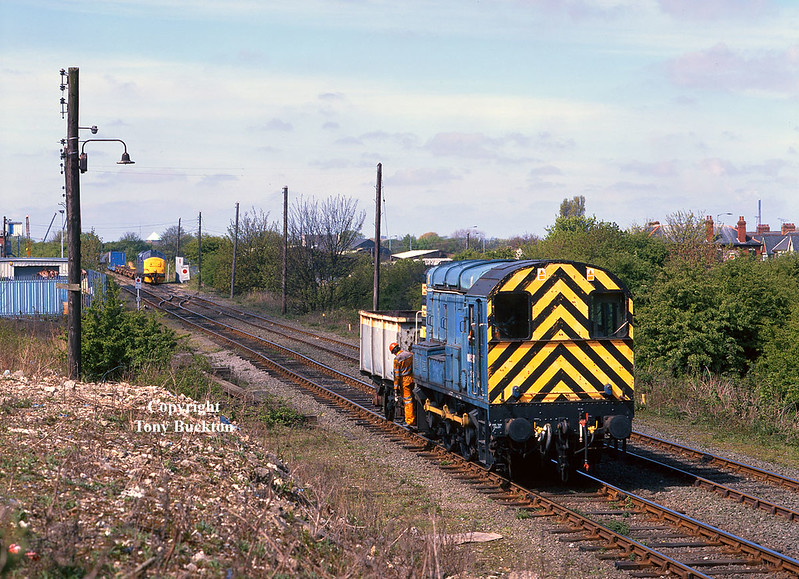 08597 propels a crippled mineral wagon towards the EWS Train office at Hull King George Dock, whilst 37248 awaits clearance to proceed onto the dock with the daily Enterprise service from Doncaster on Thursday 29th April 1999.