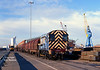 09007 shunts BYA and BDA steel carriers on 10 Quay, Hull King George Dock at 12:20 on Thursday 27th November 2003 – 56049 can be seen awaiting attachment to the train which would form the 6D54 Hull – Doncaster Enterprise wagonload service.<br /> The 'Hull Docks' headboard had been constructed for use on the 'Humber Sceptre' railtour which had ran earlier in the year.<br /> 56049 is  in the background off the Enterprise service from Doncaster.