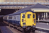 Scotrail DBSO 9701 departs Edinburgh Waverley 07 June 1984. On the rear a 47/7 controlled by TDM provides the power.