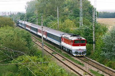 "754 085 'Xénia' approaches Trebišov with train EN 443 overnight sleeper & motorail service ""The Bohemia"" from Praha to Humenné. Friday 8th September 2017."