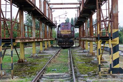 Standard gauge 742 296 is stabled in the inspection rack at Maťovské depot. Thursday 7th September 2017.