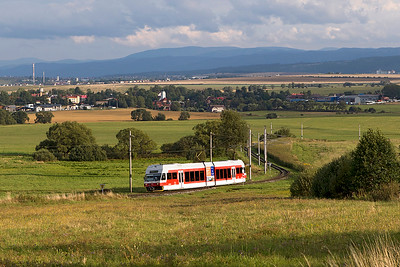 Metre gauge Stadler EMU 425 952 of the Tatranská elektrická železnica (TEŽ) climbs away from the village of Veľký Slavkov forming train 8134 17.29 Poprad-Tatry to Štrbské Pleso in the High Tatras. Wednesday 6th September 2017.