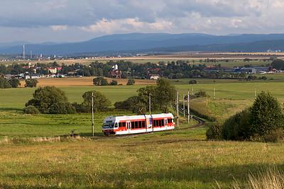Metre gauge Stadler EMU 425 952 of the Tatranská elektrická železnica (TEŽ) climbs away from the village of Veľký Slavkov forming train 8134 17.29 Poprad-Tatry to Štrbské Pleso in the High Tatras. Wednesday 6th September 2017.