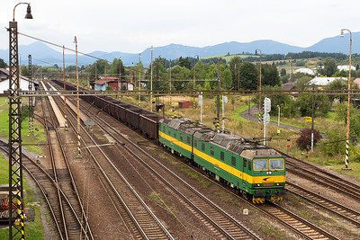 131 002 & 131 001 stand in the loop at Liptovský Mikuláš. They will leave their train of bogie opens for loading timber in the yard at a later date. Wednesday 6th September 2017.