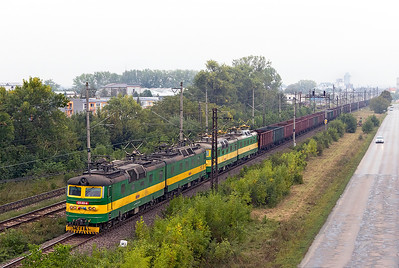 Broad gauge 125 831, 125 832, 125 837 & 125 838 pass Trebišov with a loaded iron ore train for Haniska steel works. Friday 8th September 2017.