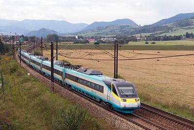CD Pendolino 682 002 forming train 241 06.43 Praha to Kosice passes Bešeňová. Wednesday 6th September 2017.