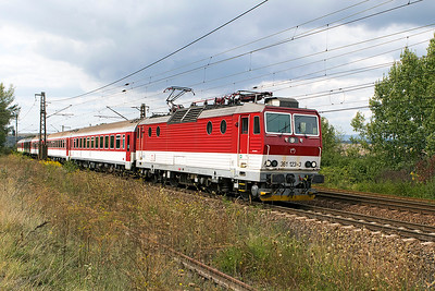 361 123 heads away from the stop at Ruskov with train 8809 12.06 Kosice to Čierna nad Tisou. The weed covered track in the foreground is a spur from Ruskov station to a quarry but has been out of use for sometime. Thursday 7th September 2017.