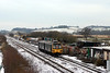 While much of Devon came to a halt on 06-02-09 as a result of snow the railways kept working here 143617 is to be found working the 1313 Paignton - Exmouth, it is seen here passing Exminster station site