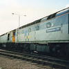 60011, 33063 & 33064 at Sevington on 09/10/90.