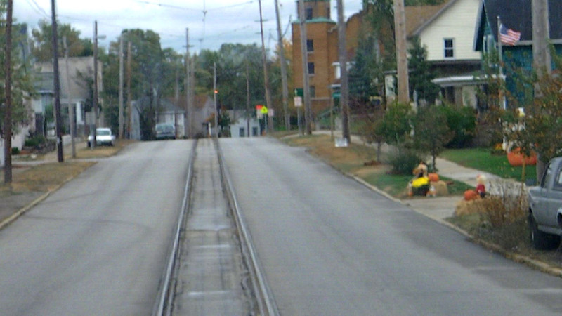 Following the stop at Michigan City, Indiana, the train resumes it street crawl through town. Viewers can see that motormen must really hate this section of the line!