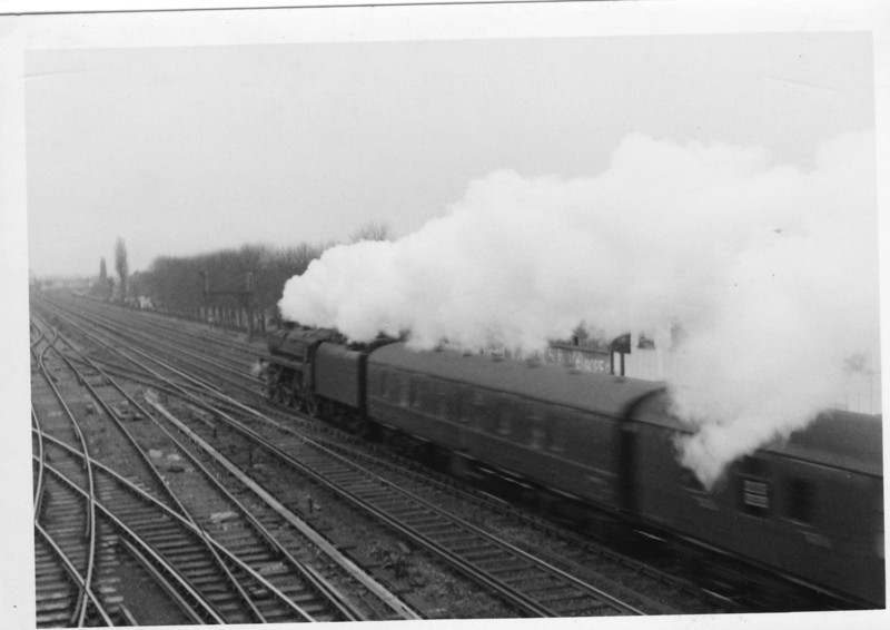 """The 12 18 Fairsky boat train from Waterloo to Southampton Docks on 08/02/66 passes Wimbledon """"C"""" signal box with Eastleigh's 73117 Vivien in charge."""