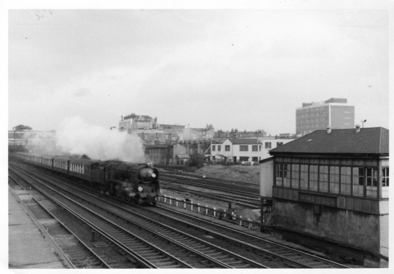 "Wimbledon ""B"" signal box witnesses Light Pacific 34087 145 Squadron passing with the down ""Belle' on 15/02/66."