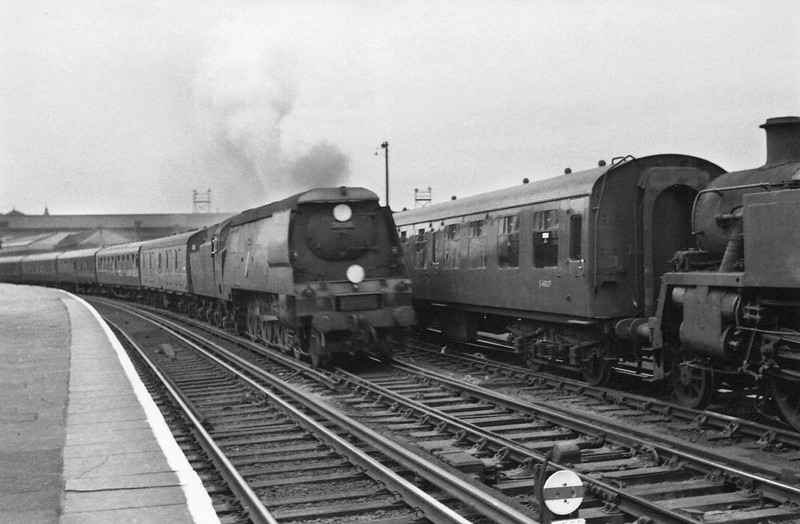 Exmouth Junction's Unmodified 34066 Spitfire passes through Clapham Junction on 30/06/64 with the 11 00 stopping service from Salisbury. She escaped the autumn cull of WR steam to finish her days at Salisbury in August 66.