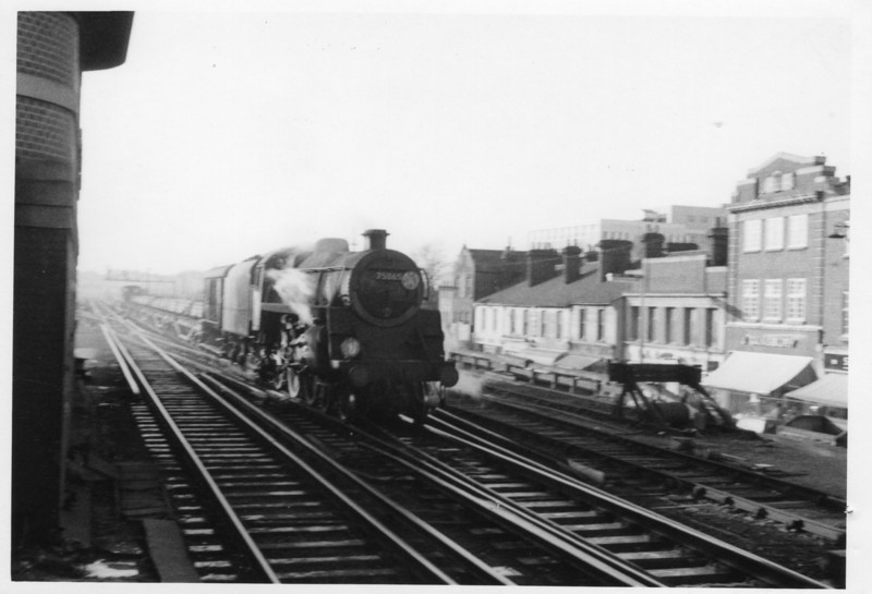 Fifteen of these double chimney version of the BR Standard 4MT 4-6-0 were allocated to the Southern Region and this is the only representative photograph I have. Eastleigh's 75065 draws out of Woking Up Yard on 27/11/65 with a long rail train from Redbridge Works.