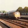 33064 passes Kensington (Olympia) on 01/10/82 with the 09 00 Willesden to Dover Town Yard.