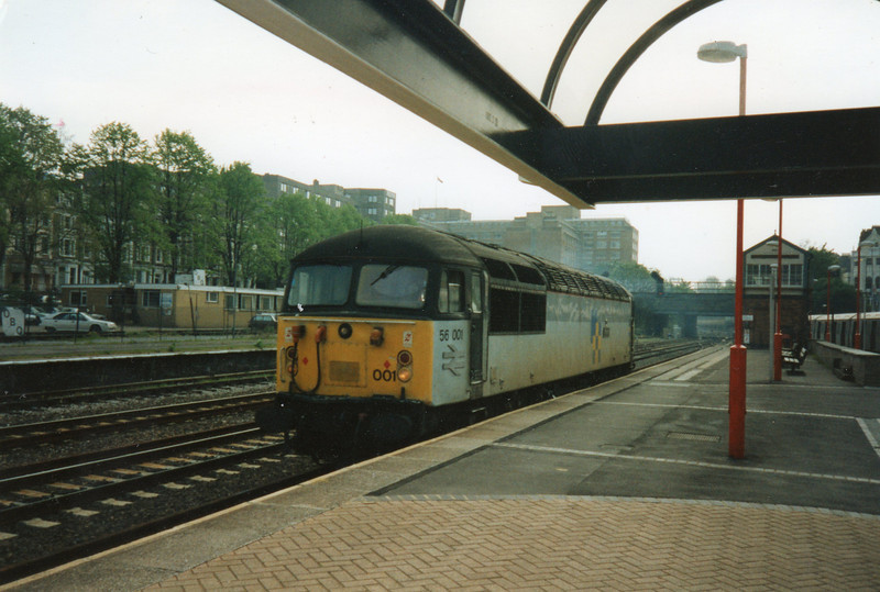 56001 running light engine through Kensington (Olympia) on 28/04/93.