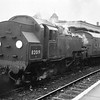 Clapham Junction on 16/02/66 sees 82019 in charge of the 08 16 departure for Kensington Olympia - the futuristic fibre glass single compartment vehicle being in the formation.