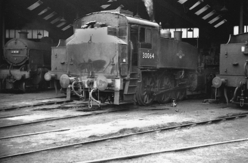 The Guildford shed pilot, Eastleigh's USA 0-6-0T 30064, seen there on 31/10/64. She was the last steam to leave the shed on Sunday 9th July 67 en route to Salisbury, Barry and eventual preservation.