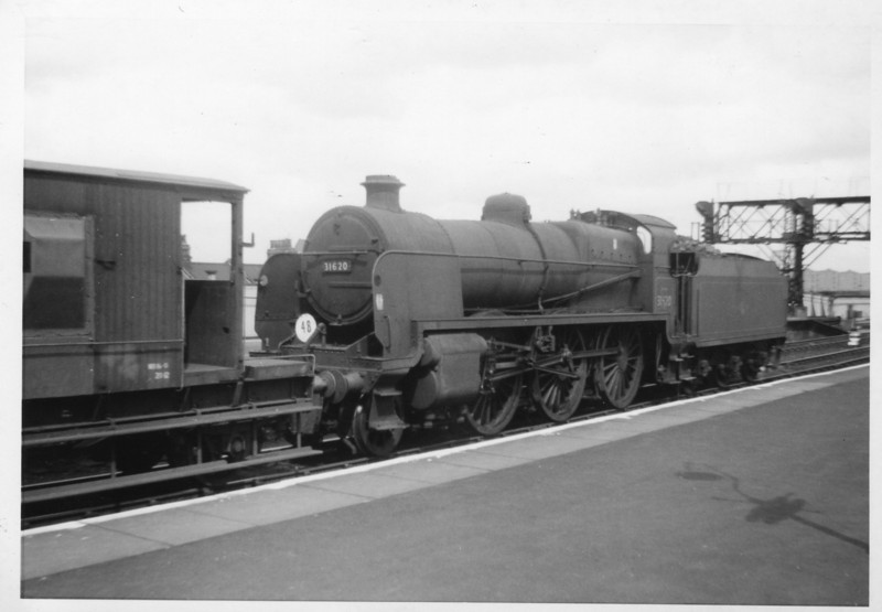 Another lunch time visit to Clapham Junction caught Guildford's U 2-6-0 31620 performing freight shunting duties on 20/04/64. She was withdrawn in March 65.