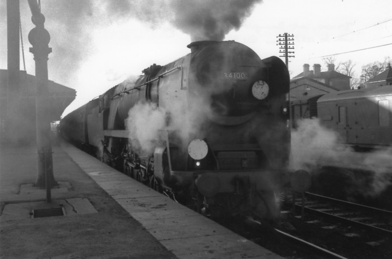 A Salisbury loco on a Bournemouth duty - 34100 Appledore is at Basingstoke on 11/12/65 with the 12 57 Bournemouth Central to Waterloo