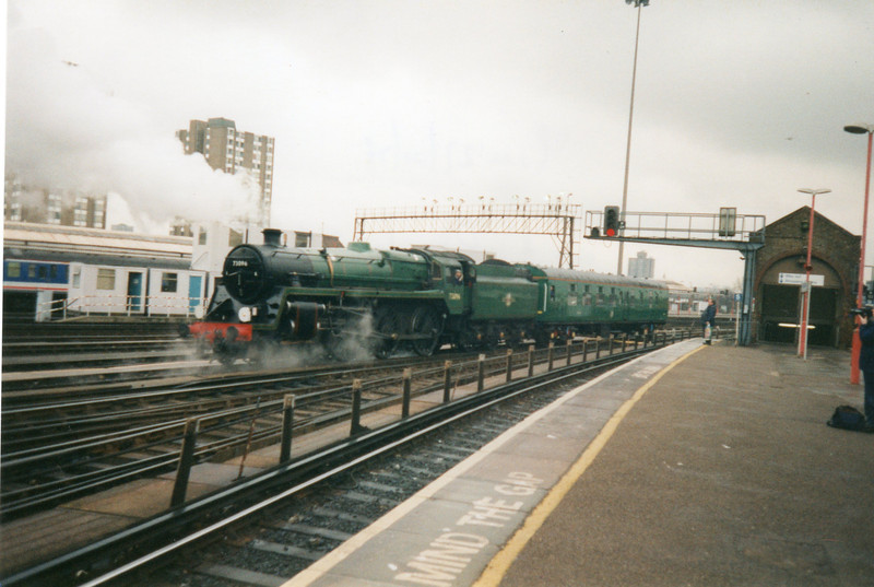 Withdrawn from Patricroft in December 67 73096 reverses out of Clapham Yard on 27/01/98 en route home to the Mid Hants Railway.