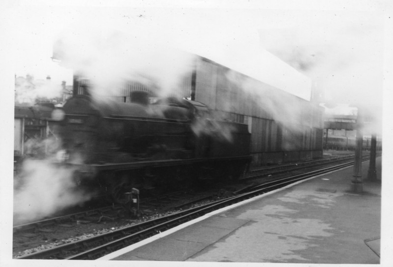 A rare (bad!) shot of a Q class 0-6-0 at Guilford on 07/12/64 - 30542 being withdrawn later that month.